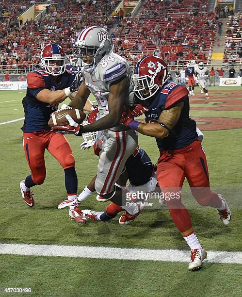 Kendal Keys of the UNLV Rebels catches a touchdown pass in the end zone against Brandon Hughes Malcolm Washington and Derron Smith of the Fresno...