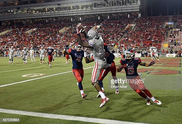 Kendal Keys of the UNLV Rebels catches a touchdown pass in the end zone against Brandon Hughes, Malcolm Washington and Derron Smith of the Fresno...