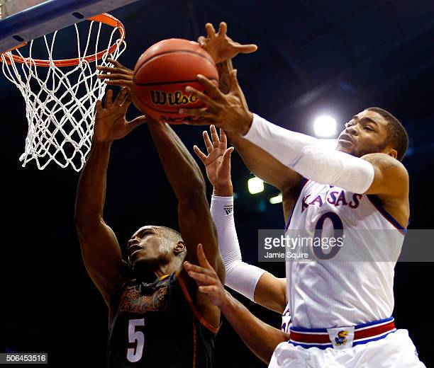 Kendal Yancy of the Texas Longhorns and Frank Mason III of the Kansas Jayhawks battle for a rebound during the game at Allen Fieldhouse on January 23...