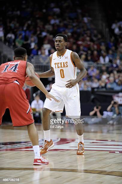 Kendal Yancy of the Texas Longhorns controls the ball against Robert Turner of the Texas Tech Red Raiders during the first round of the Big 12...