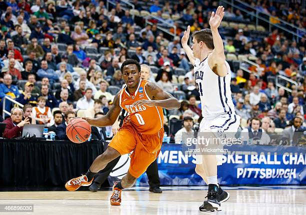 Kendal Yancy of the Texas Longhorns drives against Kellen Dunham of the Butler Bulldogs in the first half during the second round of the 2015 NCAA...