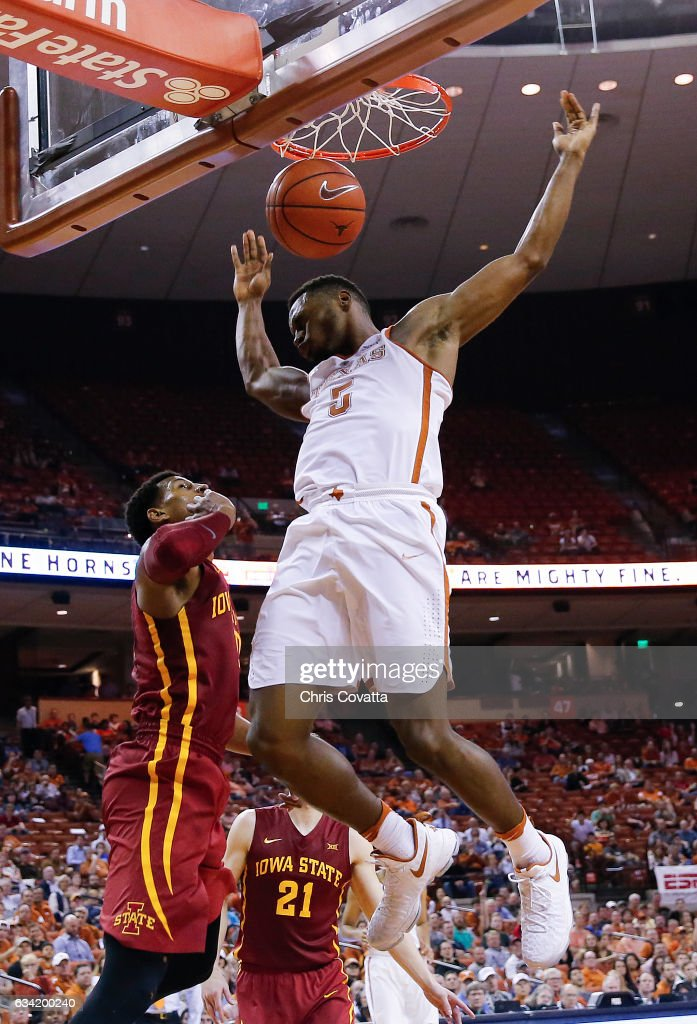 Kendal Yancy #5 of the Texas Longhorns dunks the ball over Darrell Bowie #10 of the Iowa State Cyclones at the Frank Erwin Center on February 7, 2017 in Austin, Texas.