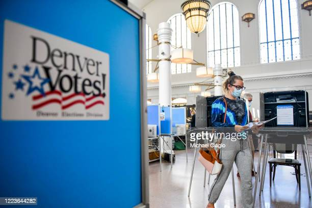 Kendall Althans votes in the primary election at the Union Station polling center on June 30, 2020 in Denver, Colorado. Voters will decide between...