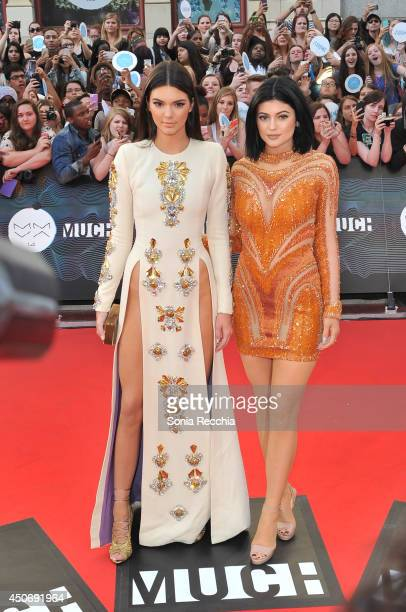 Kendall and Kylie Jenner arrive at the 2014 MuchMusic Video Awards at MuchMusic HQ on June 15 2014 in Toronto Canada