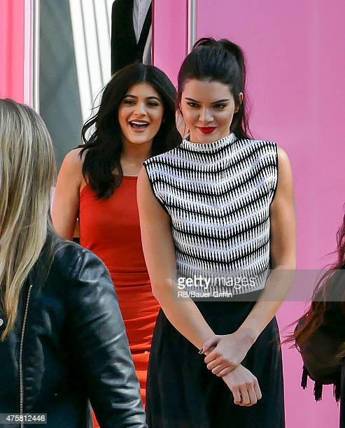 Kendall and Kylie Jenner greet fans at Topshop at The Grove in Los Angeles on June 03 2015 in Los Angeles California