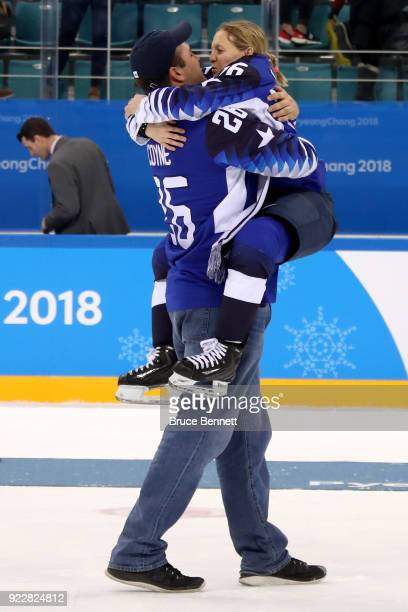 Kendall Coyne of the United States celebrates with fiance Michael Schofield after defeating Canada 32 in the overtime penaltyshot shootout to win the...
