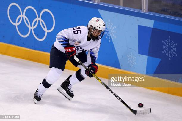 Kendall Coyne of the United States handles the puck against Canada during the Women's Ice Hockey Preliminary Round Group A game on day six of the...