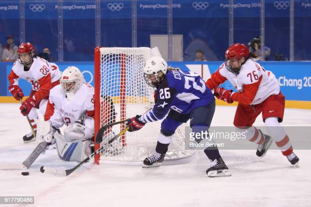 Kendall Coyne of the United States shoots against Nadezhda Morozova and Yekaterina Nikolayeva of Olympic Athlete from Russia in the third period...