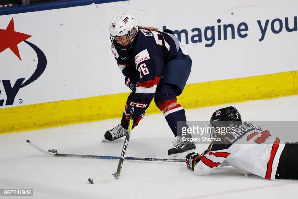 Kendall Coyne of the United States tries to control the puck next to Jocelyne Larocque of Canada at the 2017 IIHF Womans World Championships at USA...