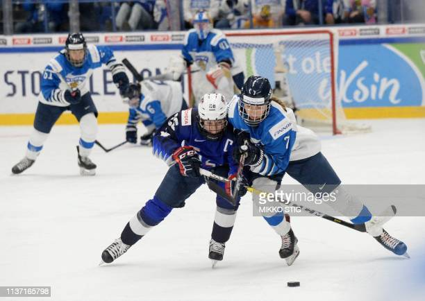 Kendall Coyne Schofield of the United States and Nelli Laitinen of Finland vie during the IIHF Women's Ice Hockey World Championships final match...