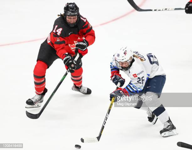 Kendall Coyne Schofield of the U.S. Women's Hockey Team and Renata Fast of the Canadian Women's National Team go for the puck in the second period at...