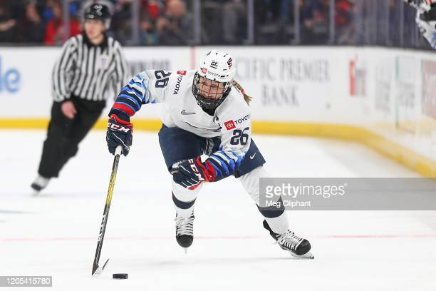 Kendall Coyne Schofield of the U.S. Women's Hockey Team skates down the ice with the puck in the game against the Canadian Women's National Team at...