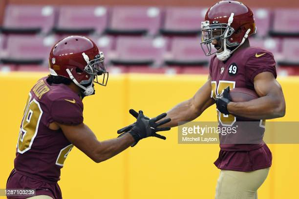Kendall Fuller and Fabian Moreau of the Washington Football Team celebrate against the Cincinnati Bengals during the second half at FedExField on...