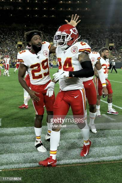 Kendall Fuller and Jordan Lucas of the Kansas City Chiefs celebrate after Lucas made an interception in the second quarter against the Green Bay...