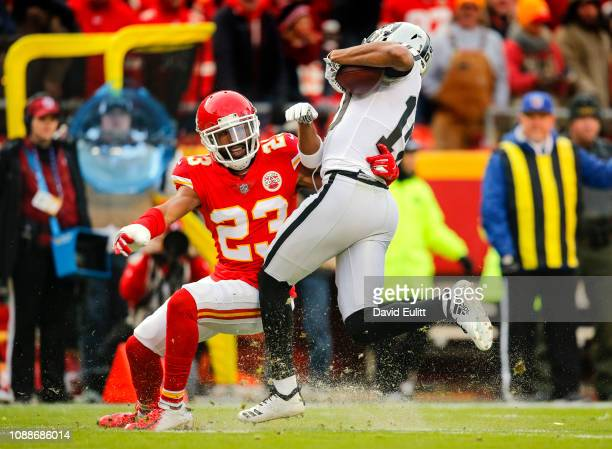 Kendall Fuller of the Kansas City Chiefs tackles Seth Roberts of the Oakland Raiders during the first quarter at Arrowhead Stadium on December 30...