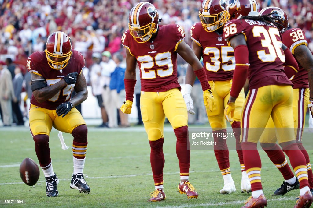 Kendall Fuller #29 of the Washington Redskins celebrates with teammates after an interception to seal the game in the fourth quarter against the San Francisco 49ers at FedEx Field on October 15, 2017 in Landover, Maryland. The Redskins won 26-24.