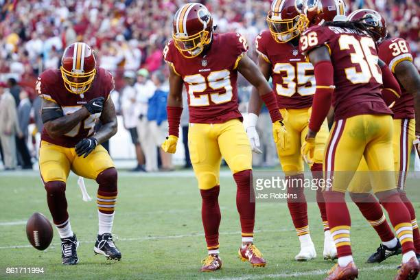 Kendall Fuller of the Washington Redskins celebrates with teammates after an interception to seal the game in the fourth quarter against the San...