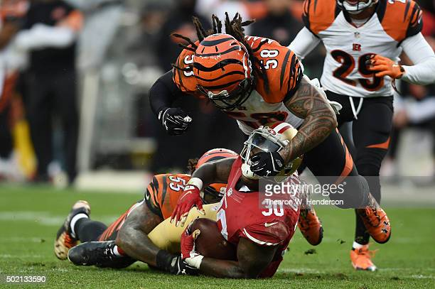 Kendall Gaskins of the San Francisco 49ers is tackled by Vontaze Burfict and Rey Maualuga of the Cincinnati Bengals during their NFL game at Levi's...