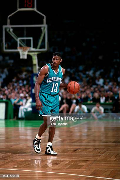 Kendall Gill of the Charlotte Hornets handles the ball against the Boston Celtics during a game played at the Boston Garden in Boston Massachusetts...