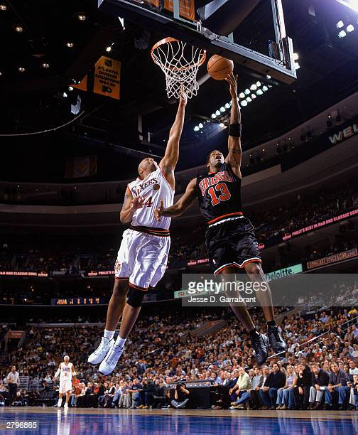Kendall Gill of the Chicago Bulls goes to the hoop against Derrick Coleman of the Philadelphia 76ers during the NBA game at Wachovia Center on...