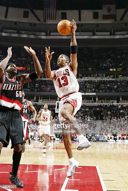 Kendall Gill of the Chicago Bulls shoots over Zach Randolph of the Portland Trail Blazers during the third quarter of a NBA game against the Portland...