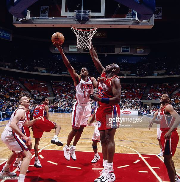 Kendall Gill of the New Jersey Nets shoots against the Philadelphia 76ers circa 1997 at the Contintental Airlines Arena in East Rutherford New Jersey...