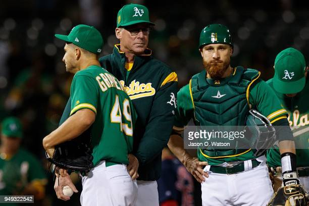 Kendall Graveman of the Oakland Athletics is relieved by manager Bob Melvin during the sixth inning against the Boston Red Sox at the Oakland...