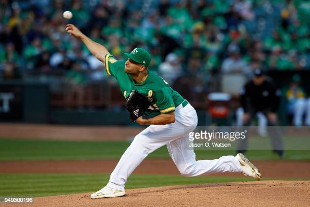 Kendall Graveman of the Oakland Athletics pitches against the Boston Red Sox during the first inning at the Oakland Coliseum on April 20 2018 in...