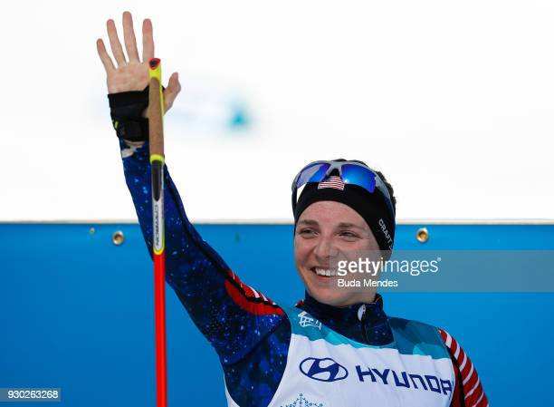 Kendall Gretsch of the United States celebrate after crossing the finish line in first place in the Women's Cross Country 12km Sitting event at...