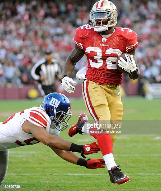 Kendall Hunter of the San Francisco 49ers rushes seventeen yards for a touchdown against the New York Giants during an NFL football game at...