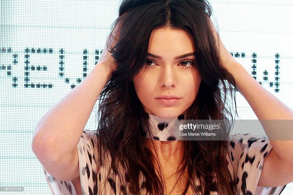Kendall Jenner adjusts her hair on stage at Westfield Parramatta on November 17, 2015 in Sydney, Australia.