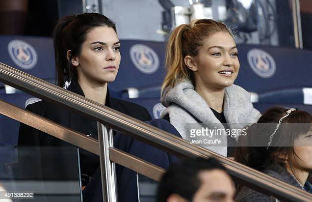 Kendall Jenner and Gigi Hadid attend the French Ligue 1 match between Paris SaintGermain FC and Olympique de Marseille at Parc des Princes stadium on...