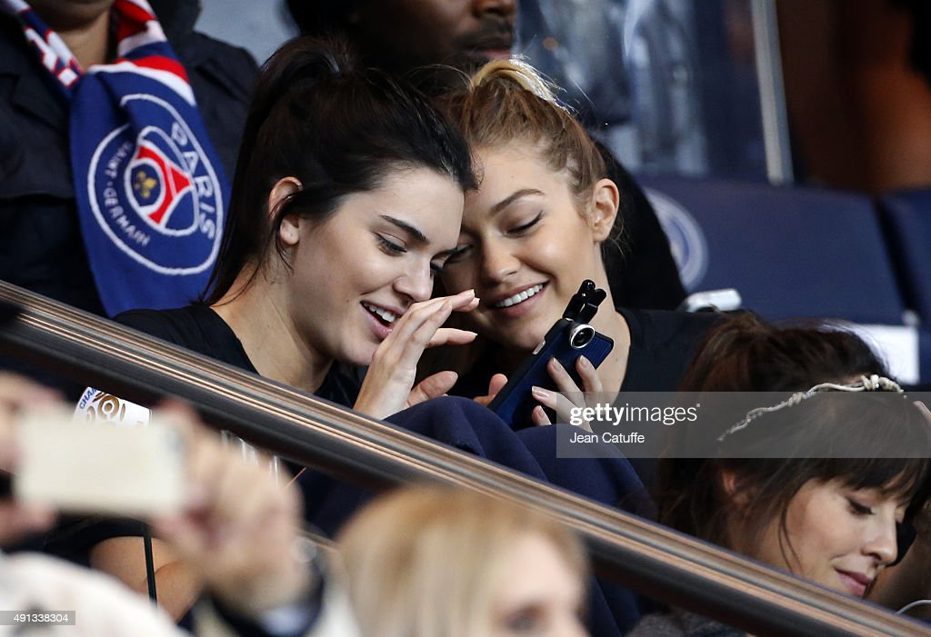 Kendall Jenner and Gigi Hadid attend the French Ligue 1 match between Paris Saint-Germain FC (PSG) and Olympique de Marseille at Parc des Princes stadium on October 4, 2015 in Paris, France.