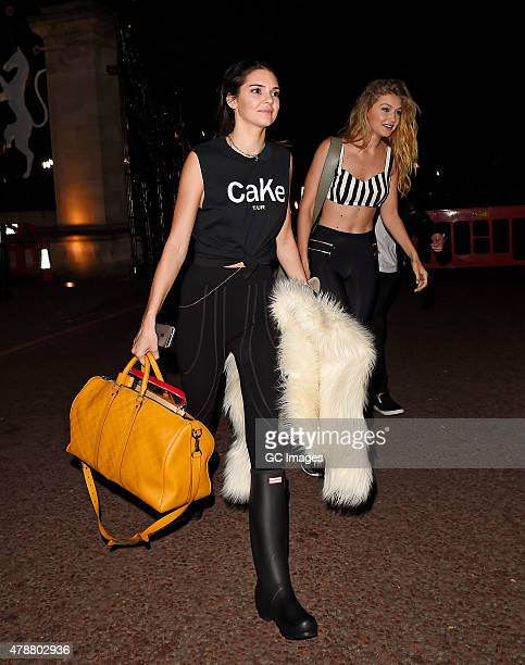 Kendall Jenner and Gigi Hadid leave Hyde Park after watching Taylor Swift and Ellie Goulding perform on June 27, 2015 in London, England.