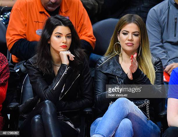 Kendall Jenner and Khloe Kardashian attend a basketball game between Dallas Mavericks and the Los Angeles Clippers at Staples Center on January 10...