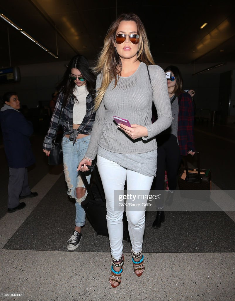 Kendall Jenner and Khloe Kardashian with Kylie Jenner are seen at LAX on April 02, 2014 in Los Angeles, California.