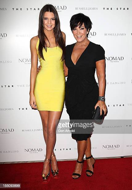 Kendall Jenner and Kris Jenner pose at the book launch of 'Nomad Two Worlds' by Russell James on November 1 2012 in Sydney Australia