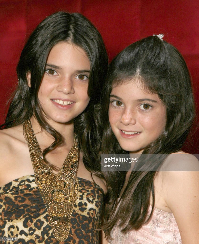 Kendall Jenner and Kylie Jenner pose for a photo at the 'Keeping Up With the Kardashians' viewing party at Chapter 8 Restaurant on October 16, 2007 in Agoura Hills, California.