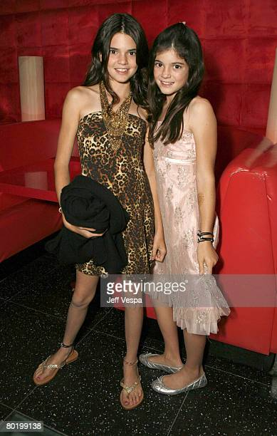 Kendall Jenner and Kylie Jenner pose for a photo at the Keeping Up With the Kardashians viewing party at Chapter 8 Restaurant on October 16 2007 in...