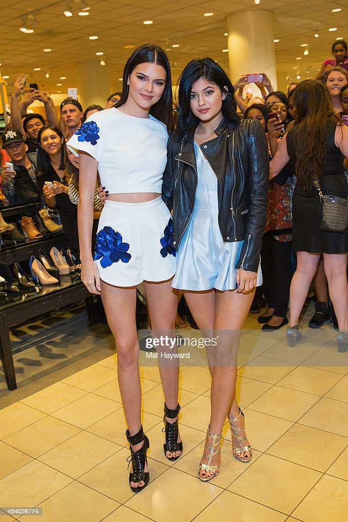 Kendall jenner and kylie jenner pose for a photo at the madden girl madden girl meet and greet with kendall jenner and kylie jenner at nordstrom downtown seattle m4hsunfo