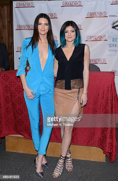 """Kendall Jenner and Kylie Jenner promote """"Rebels: City Of Indra"""" at Bookends Bookstore on June 3, 2014 in Ridgewood, New Jersey."""