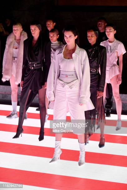 Kendall Jenner and models pose on the runway during the Alexander Wang Collection 1 fashion show at Rockefeller Center on May 31 2019 in New York City