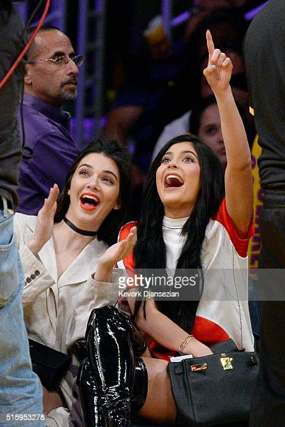 Kendall Jenner and sister Kylie Jenner attend Los Angeles Lakers and Sacramento Kings basketball game at Staples Center March 15 in Los Angeles,...