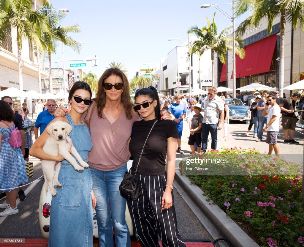 Kendall Jenner, Caitlyn Jenner and Kylie Jenner pose for a photo as Caitly Jenner displays her Austin-Healey Sprite at the Rodeo Drive Concours d'Elegance on June 18, 2017 in Beverly Hills, California.