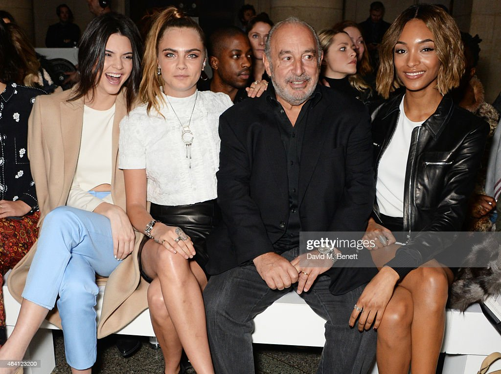 Kendall Jenner, Cara Delevingne, Sir Philip Green and Jourdan Dunn attend the Topshop Unique show during London Fashion Week Fall/Winter 2015/16 at Tate Britain on February 22, 2015 in London, England.