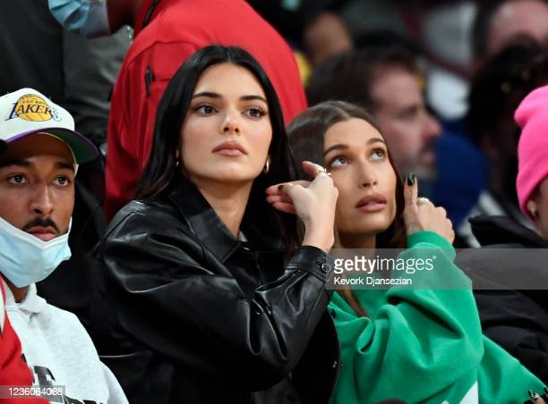 Kendall Jenner, Hailey Bieber and Justin Bieber attend the Phoenix Suns and Los Angeles Lakers baseball game at Staples Center on October 22, 2021 in...