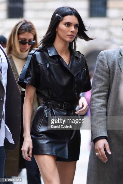Kendall Jenner is seen wearing a black leather dress outside the Longchamp show during New York Fashion Week Fall/Winter 2019 on February 09 2019 in...