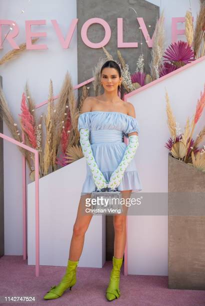 Kendall Jenner is seen wearing blue off shoulder dress, gloves with print, green sock boots at Revolve Festival during Coachella Festival on April...