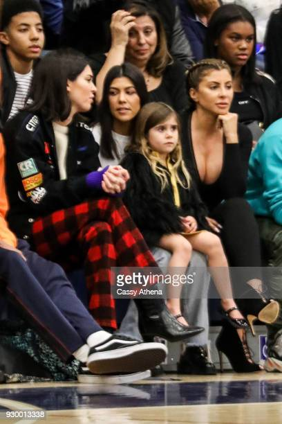 Kendall Jenner Kourtney Kardashian daughter Penelope Disick and Larsa Younan watch courtside as Sierra Canyon plays Foothills Christian for the CIF...