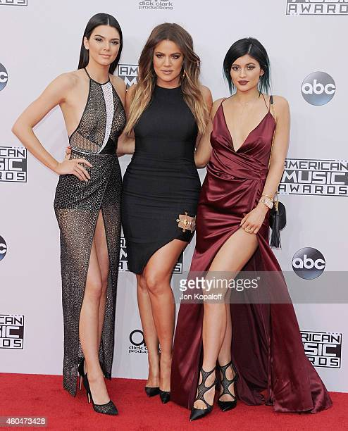 Kendall Jenner Kylie Jenner and Khloe Kardashian arrive at the 2014 American Music Awards at Nokia Theatre LA Live on November 23 2014 in Los Angeles...